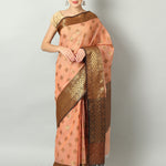 Peach kota saree with gold booties and black border