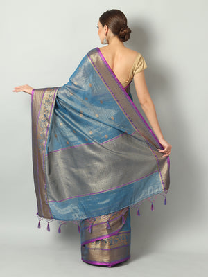 Turquoise blue shimmer zari linen saree with antique gold zari booties and border
