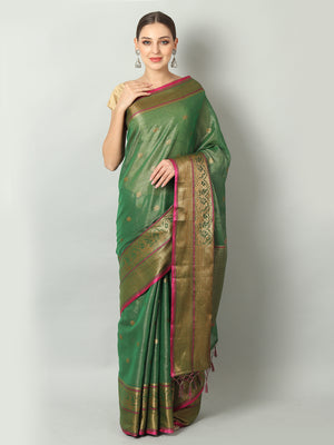 Bottle green shimmer zari linen saree with antique gold zari booties and border