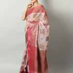 Light pink zari kota saree with gold booties and red border