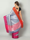 Greyish blue self brocade cotton silk saree with contrasting borders
