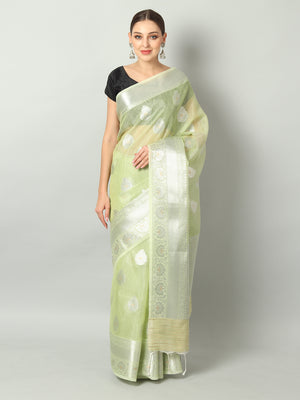 Silver booties and pink border on pastel green kota saree
