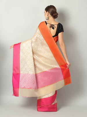Cream golden self brocade cotton silk saree with contrasting borders