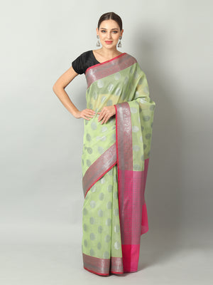 Silver booties and pink border on green kota saree