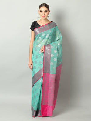 Silver booties and pink border on dark green kota saree