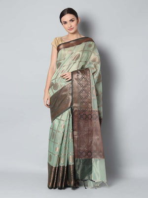 Antique gold checks on light green zari kota saree with black zari border
