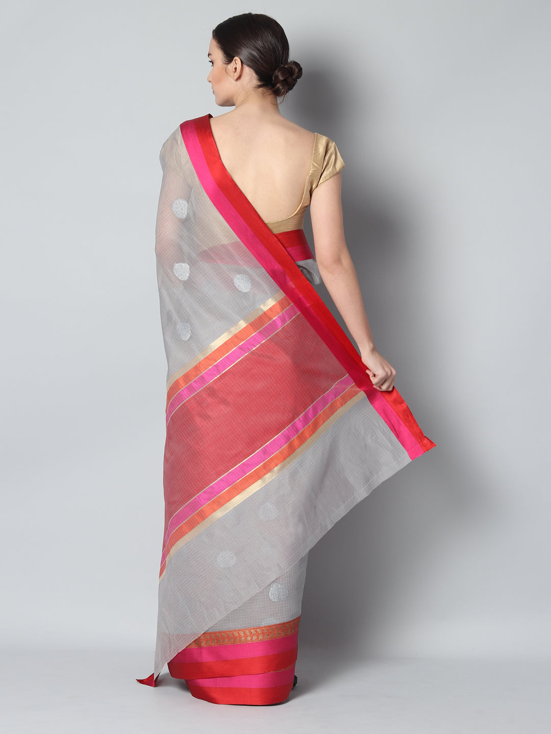 Gray kota saree with silver zari booties and contrasting borders