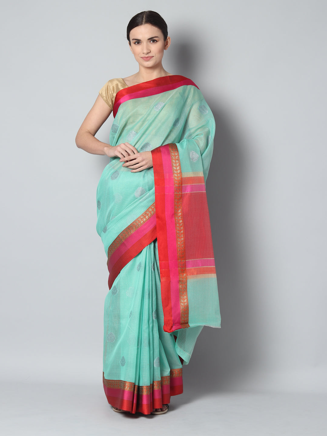 Light green kota saree with silver zari booties and contrasting borders