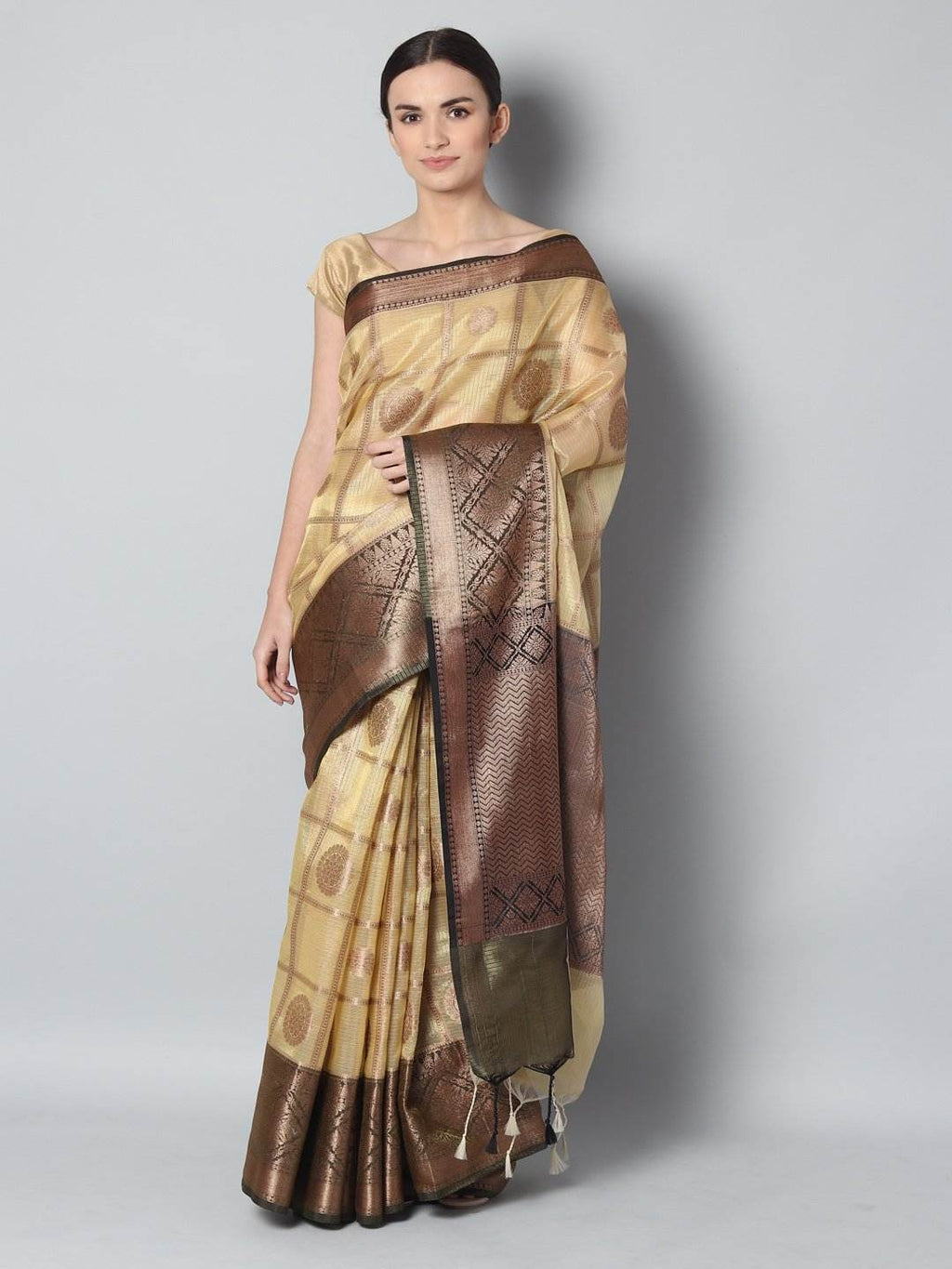 Antique gold checks on yellow zari kota saree with black zari border