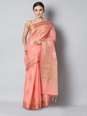 Peach kota saree with silver and gold flowers spread overall