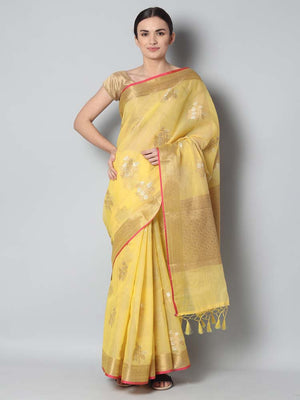 Yellow kota saree with silver and gold flowers spread overall
