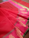 Red chanderi saree with pink border and flowers motifs on it
