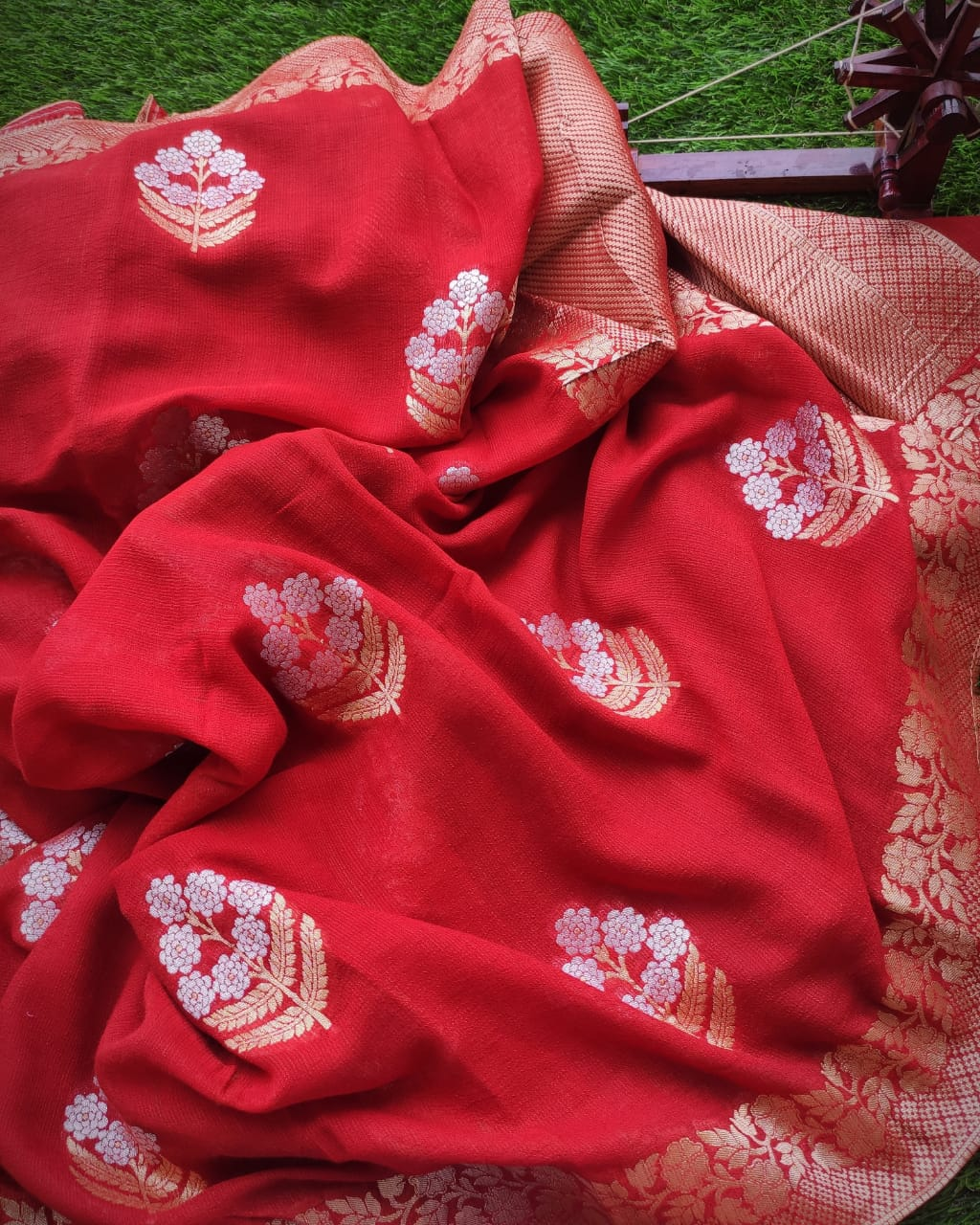 Red pure Georgette saree with silver and gold zari booties