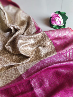Off white pure silk saree with golden weaving all over & pink border