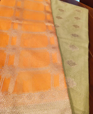 Orange organza dupatta with silver zari checks on green zari kurta dress material - EthnicRoom