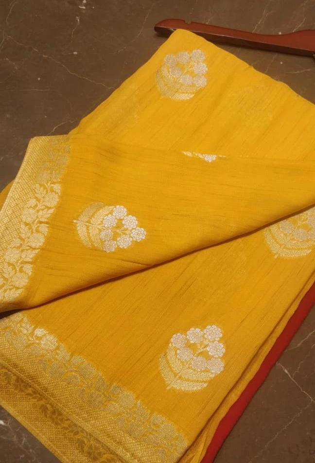 Bright yellow pure khaddi Georgette saree with silver and gold zari booties