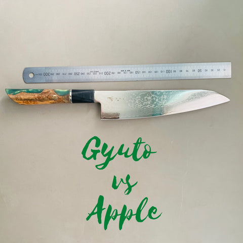 Gyuto knife slicing an apple