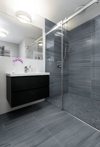 Sequence porcelain grey tile with herringbone in the shower