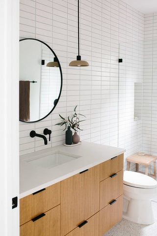 stacked subway tile matte in small bathroom white light