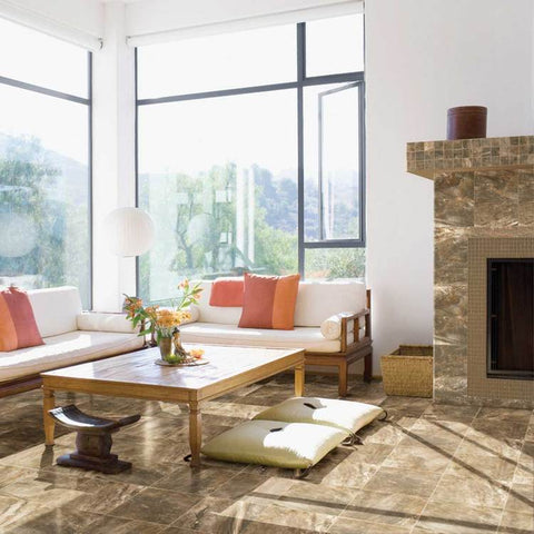Living room with tall white walls, a brown tile fireplace, and brown tile riverbed floor