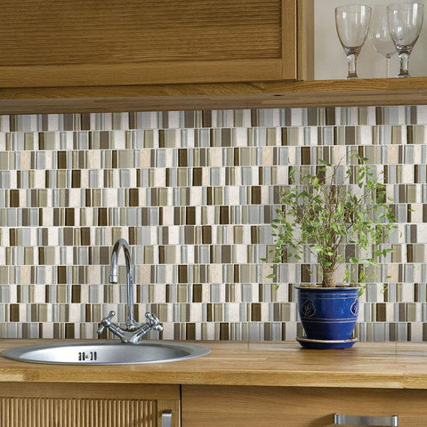 Multi-colored tile, mosaic backsplash above sink with wood countertops