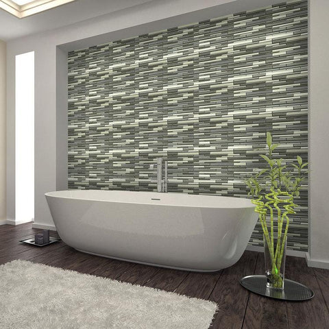 Multi-colored line mosaic tile accent wall behind standalone modern bathtub
