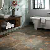 Bathroom with white standalone tub, brown floating countertop, 1 tile accent wall, and brown/grey slate tile floors