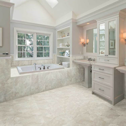 Large bathroom with tall ceilings, a built-in tub and beautiful marble-looking tile