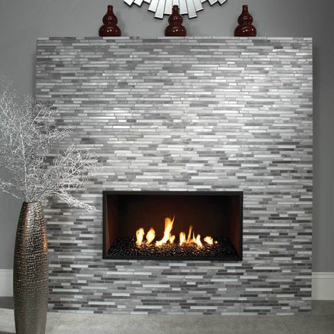 Tall greyscale tile lit fireplace with tall vase in front