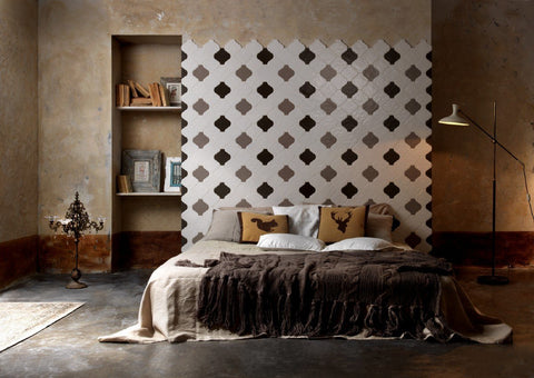 decorative grey, browns, and white tile above a bed as a tile headboard