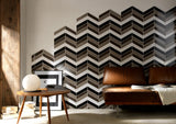 cheveron pattern tiles up wall in grey, brown, and white