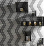 grey and white tile in chevron pattern on wall with retail products