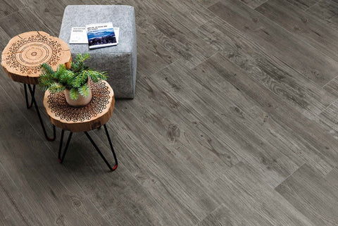 Grey tile with wood grain on floor with wood tables and grey square