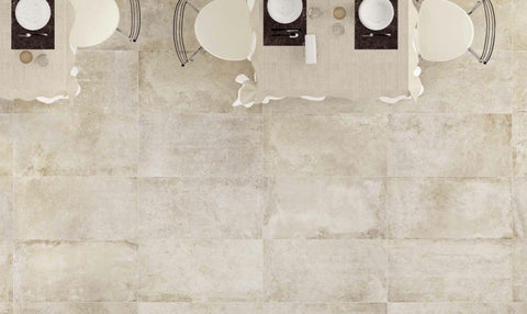 almond color tile on floor pictured from overhead with dining tables and chairs
