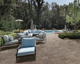 tile on outdoor patio with blue lounge chairs and swimming pool