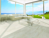 white oak color natural lookng wood tile show on living room floor with ocean view