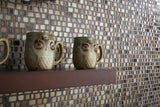 glass mosaics tile in shades of brown as a kitchen wall with owl coffee mugs