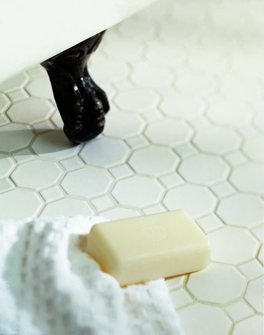octagon tile with white matte dot on bathroom floor
