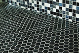 matte ebony hexagon tiles on the floor, exotic mosaic on the wall