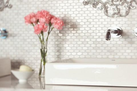 contempo white oval mosaic tile shown in bathroom backsplash