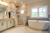 bianco marble tile shown in a bright bathroom on walls and floor.