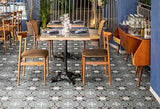 Intricately patterned tile in outdoor kitchen area with several tables