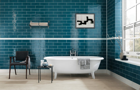 jean blue ceramic tile on wall with white bathtub