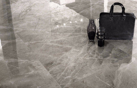 grey marble patterned tile as floor with black laptop bag