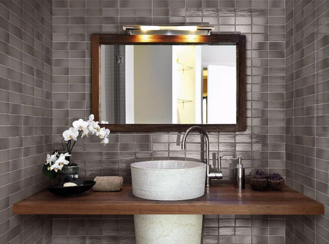 Pewter tile on a bathroom vanity wall with sink