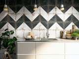 Diagonal tile pattern on the wall of a modern kitchen.