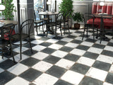Black and white checkerboard tile floor in restaurant.