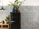 Floral pattern on the wall of a modern kitchen behind retro fridge.