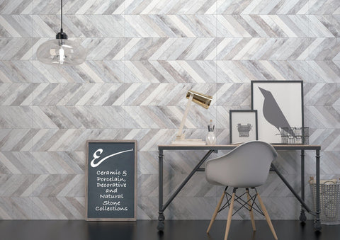 force, stone-like tiles in grey and white and chevron pattern shown on wall with a desk and images