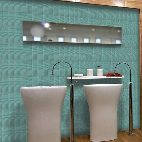 Wavy, fountain blue tile on bathroom wall behind 2 standalone white sinks and a wide mirror